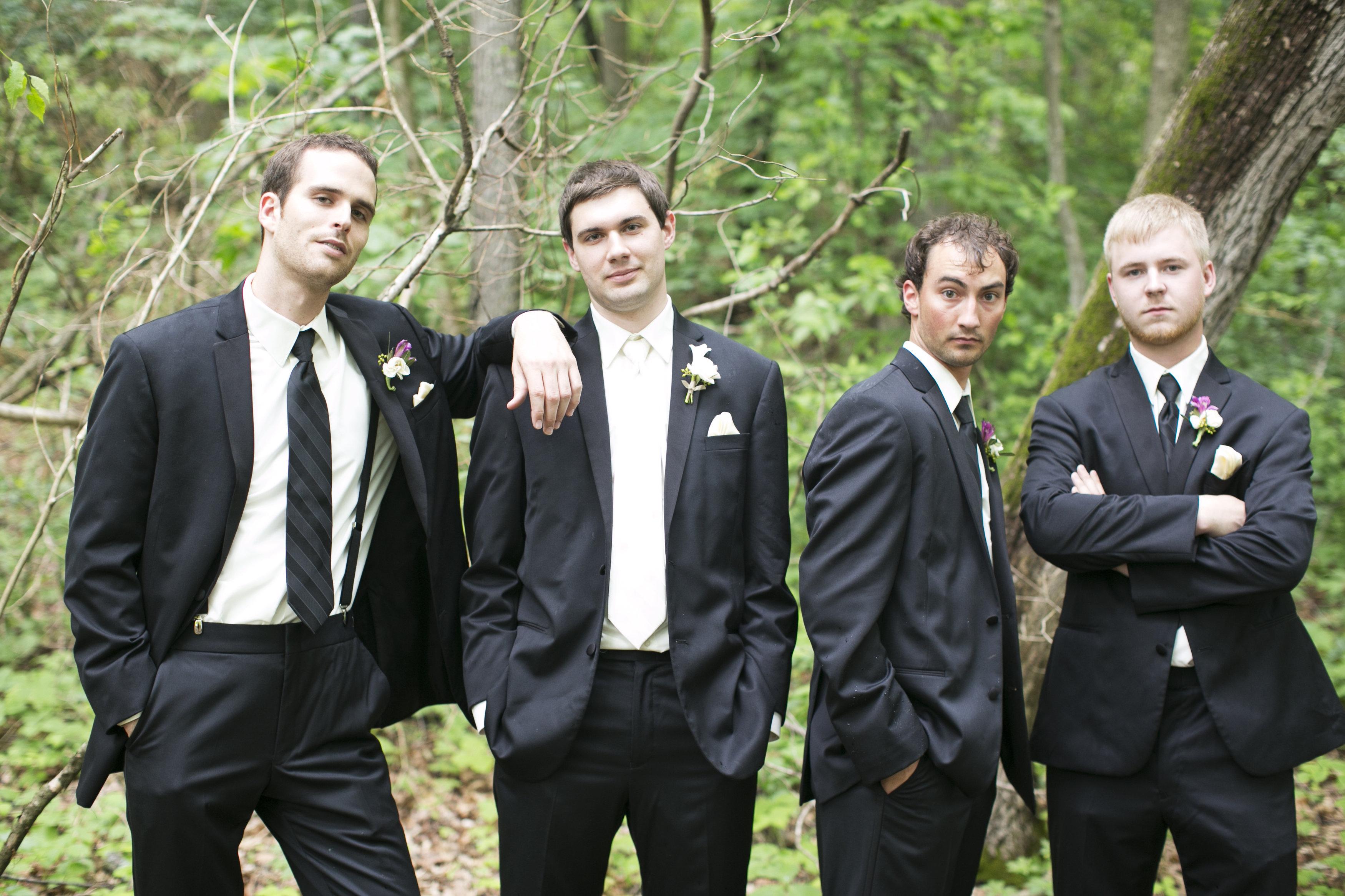 groom and groomsmen in black suits