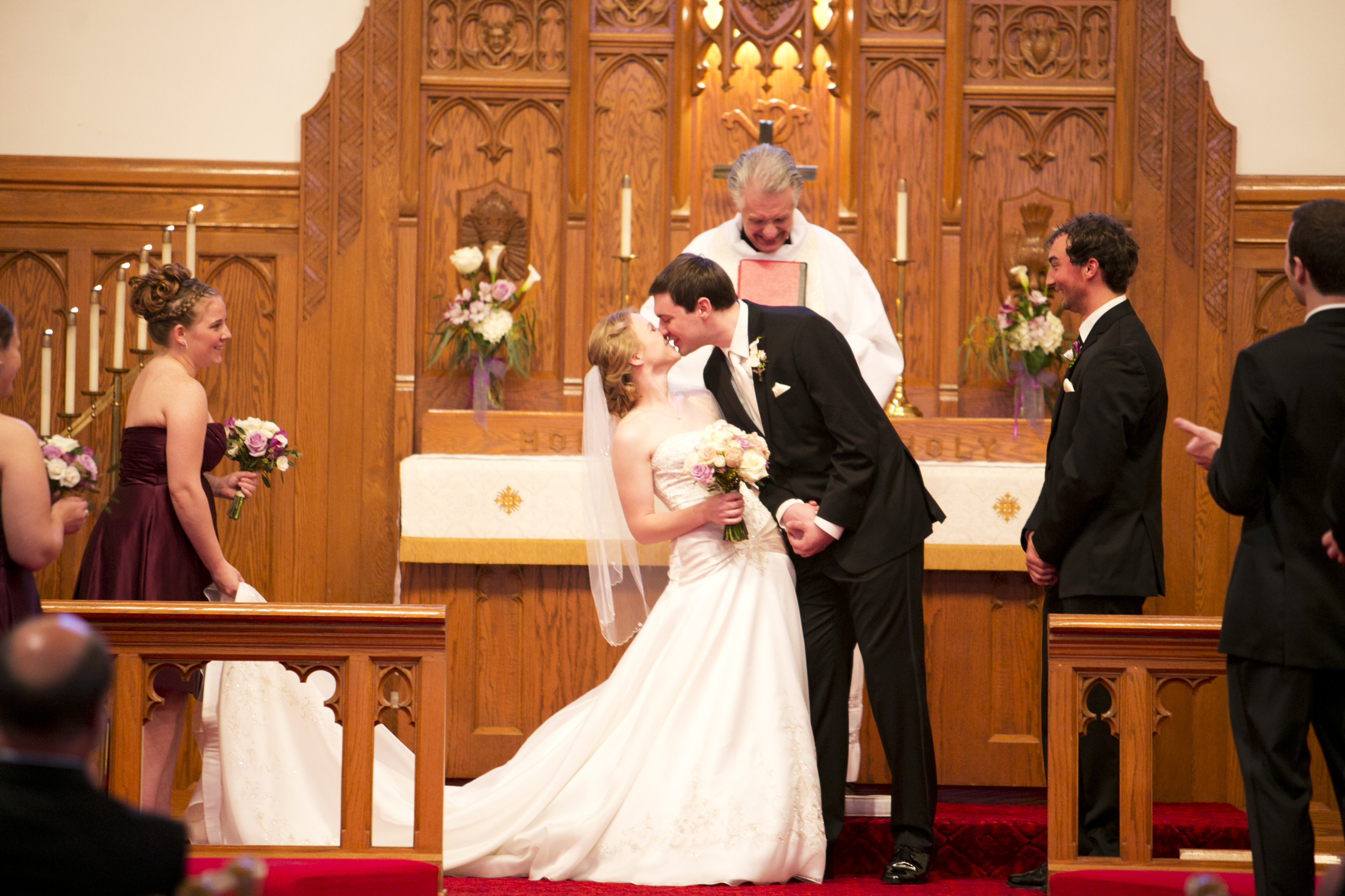 bride and groom kissing wedding ceremony first kiss