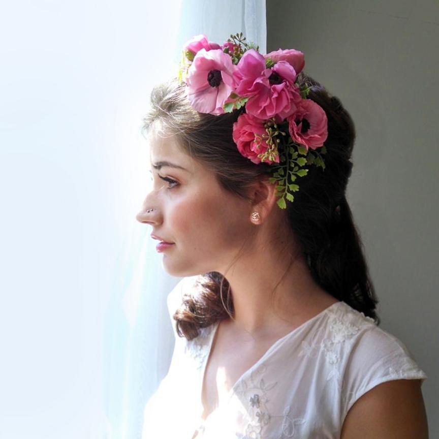 a lush pink ranunculus floral crown
