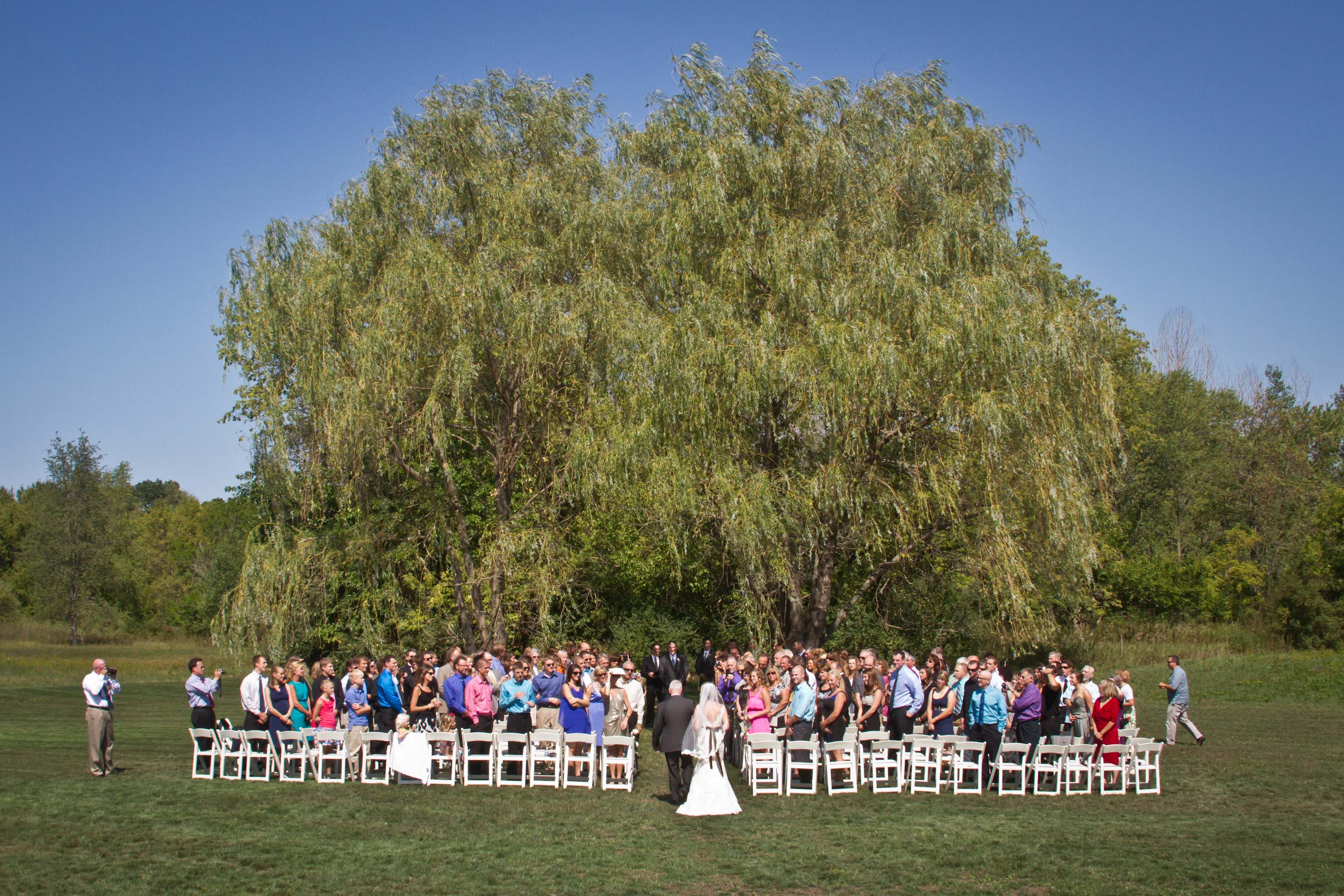 outdoor wedding ceremony space at barn at harvest moon pond