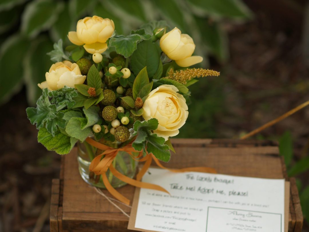 gold roses and bronze amaranthus with scented geranium
