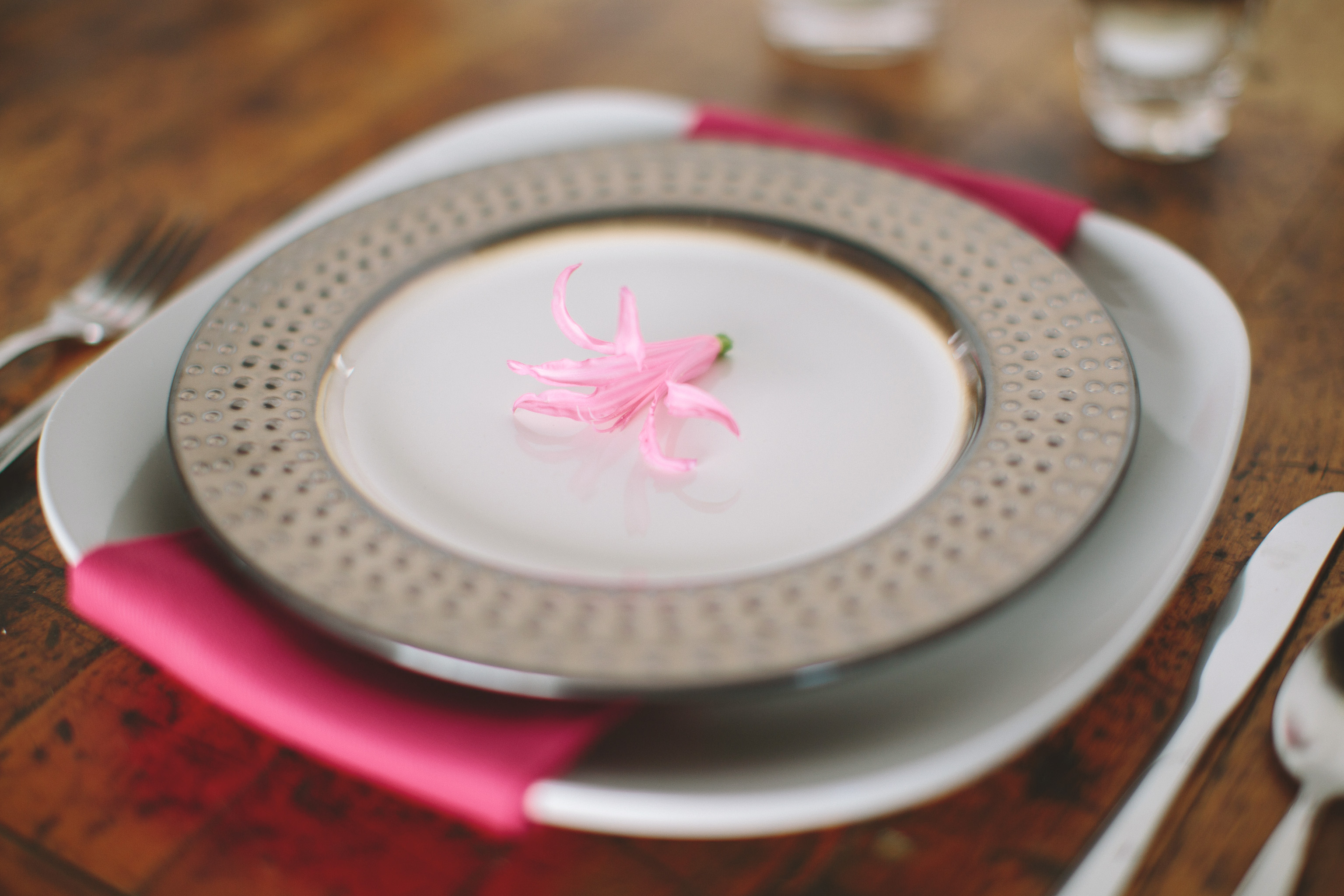 plate with pink napkin and pink flower accent