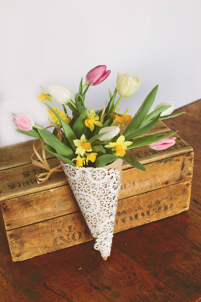 homemade may day basket filled with spring garden clippings