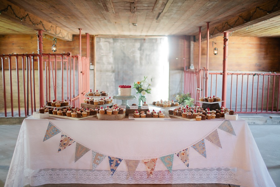 rustic dessert buffet with bunting at Over the Vines Edgerton WI