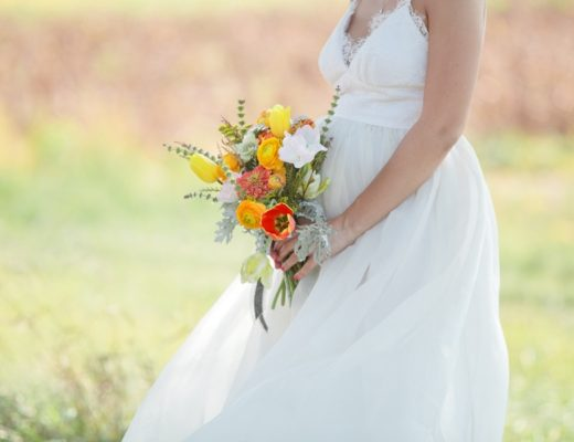 bright rustic bridal bouquet at Over the Vines with soft pastel background