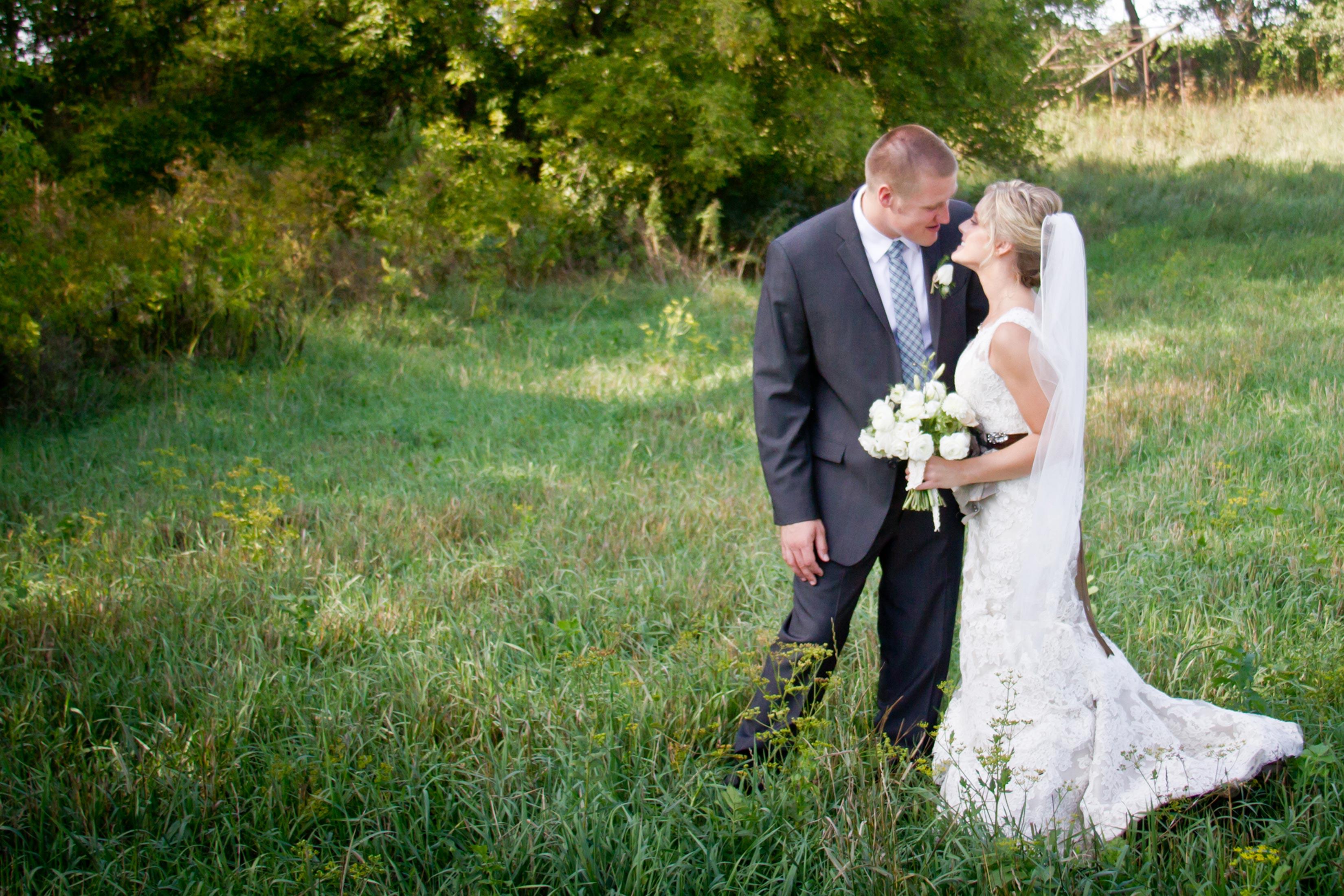 romantic wedding portrait outdoors at barn at harvest moon pond