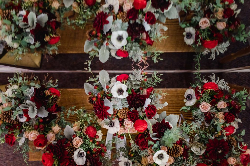 red and white winter wedding bouquets by Alluring Blooms Madison Wisconsin