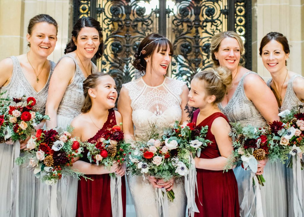 laughing bride with her bridesmaids Madison WI Edgewater wedding by Alluring Blooms