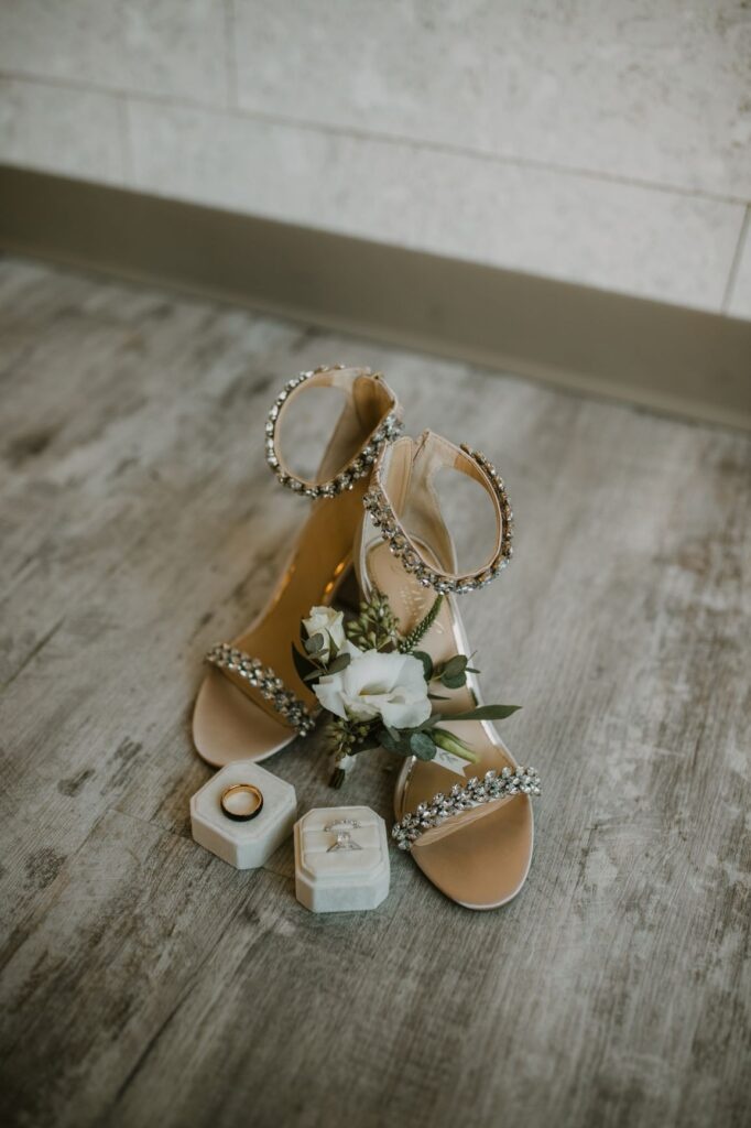bling bridal shoes with rings and grooms boutonniere