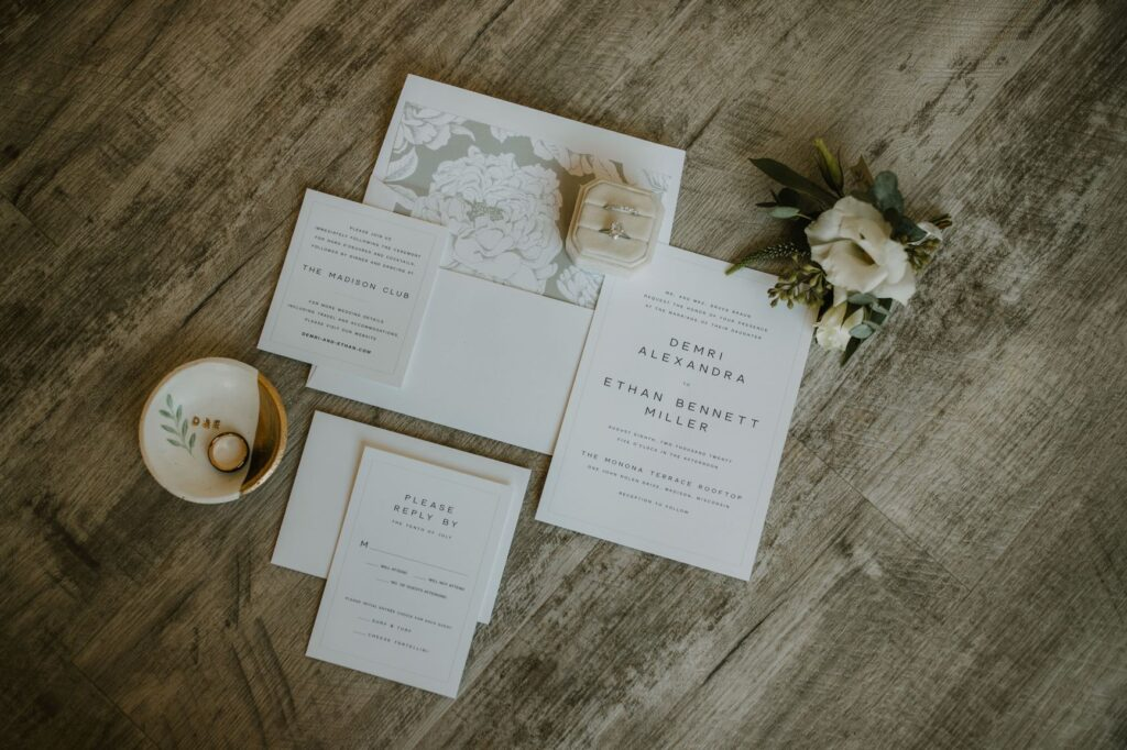 elegant neutral wedding invitation suite with rings and floral